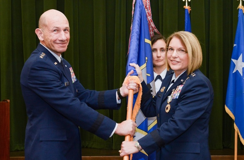 U.S. Air Force Gen. Mike Holmes, Air Combat Command commander, relieves Maj. Gen. Mary F. O'Brien of command during the Twenty-Fifth Air Force change of command ceremony