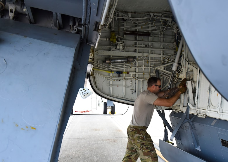 U.S. Air Force Tech Sgt. Patrick Forbes, 92nd Aircraft Maintenance Squadron flying crew chief, prepares a KC-135 Stratotanker for aerial refueling.