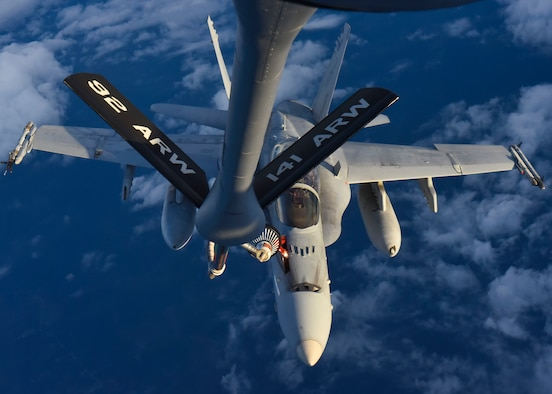 A U.S. Marine Corps F/A-18C Hornet from Marine Aircraft Group 31, South Carolina, gets refueled by a KC-135 Stratotanker