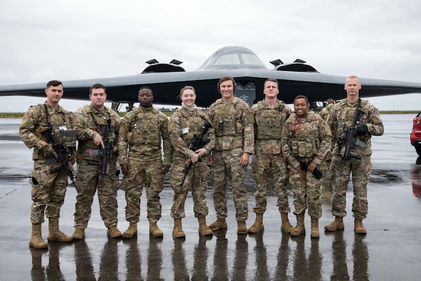 Security Forces Airmen from Whiteman Air Force Base, Missouri, pose in front of a B-2 Spirit Bomber at Naval Air Station Keflavik, Iceland, August 28, 2019, during a hot-pit refueling. Hot-pit refueling is a method of refueling an aircraft without shutting down the engines. This is the B-2s first time landing in Iceland. Forward locations like Iceland enhance the collective defense capabilities of both the U.S. and NATO allies.