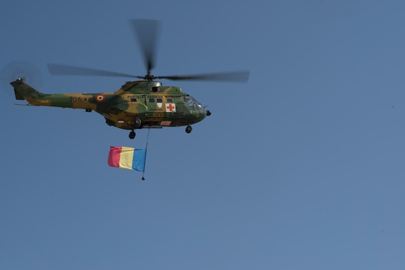 A Romanian air force paramedic helicopter returns from an air show held near Otopeni Air Base, Romania, Aug. 24, 2019. The air show, occurring at the same time as exercise Carpathian Fall, required a lot of time and resources from the Romanian air force. (U.S. Air Force photo by Senior Airman Kristof J. Rixmann)