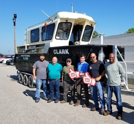 """IN THE PHOTO, from left to right, are Cory Roberts (Electrician Leaderman), Joseph """"Clay"""" Hurt (Carpenter), Mikel """"Buck"""" Buchanan (Marine Mechanic), Kevin Woods (Chief of Plant Section), Chris Reger (Rock Island District Dredge Coordinator), and Marvin Roddy (Chief of Shops Unit)."""