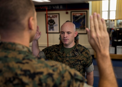 U.S. Marine Corps Gunnery Sergeant Matthew R. Phagan, a Music Technical Assistant with 6th Marine Corps District, recites the oath of enlistment during his reenlistment ceremony at the 6th Marine Corps District Headquarters aboard Marine Corps Recruit Depot Parris Island, South Carolina on August 29, 2019. Phagan is a native of Daleville, Alabama. (U.S. Marine Corps photo by Cpl. Jack A. E. Rigsby)