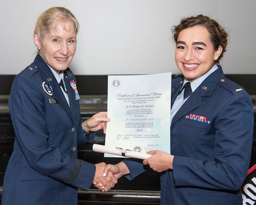 U.S. Air Force Brig. Gen. Jeannie Leavitt, Air Force Recruiting Service commander, presents 2nd Lt. Alyssa Garmon her certificate of aeronautical rating during Pilot Training Next graduation ceremony Aug. 29 at Joint Base San Antonio-Randolph.