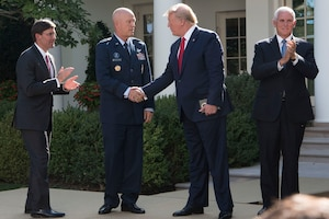President Donald J. Trump shakes hands with an Air Force general.