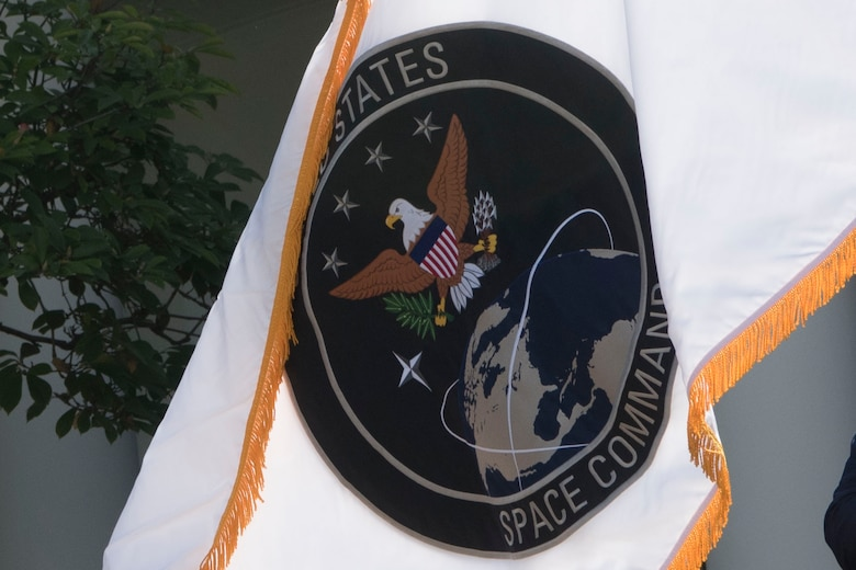 The flag of the U.S. Space Command is unfurled at the White House in a presentation with President Donald J. Trump, the incoming commander of U.S. Space Command, Air Force Gen. John W. Raymond, Vice President Mike Pence, Secretary of Defense Dr. Mark T. Esper, and Air Force Command Chief Master Sergeant Roger Towberman, Washington, D.C., Aug. 29, 2019.