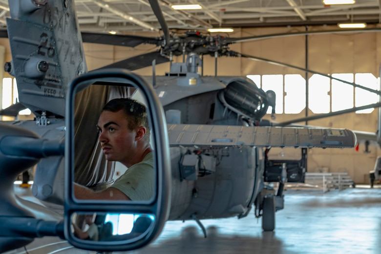 An Airman assigned to the 723d Aircraft Maintenance Squadron operates a tow truck pushing an HH-60G Pave Hawk into a hangar Aug. 30, 2019, at Moody Air Force Base, Ga. All Moody aircraft were hangared or secured in anticipation of Hurricane Dorian. (U.S. Air Force photo by Airman 1st Class Hayden Legg)
