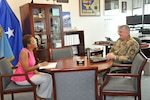 Keisha High sits with Air Force Brig. Gen. Albert Miller