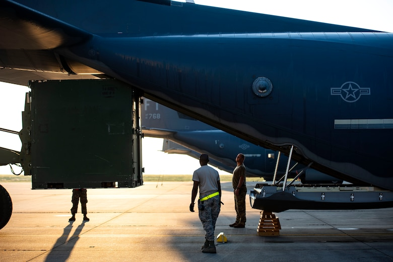 Airmen from the 71st Rescue Squadron load equipment onto an HC-130J Combat King II Aug. 30, 2019, at Moody Air Force Base (AFB), Ga. The aircraft was used to transport personnel and equipment to Little Rock AFB, Ark. in support of Hurricane Dorian aircraft relocation efforts. (U.S. Air Force photo by Senior Airman Erick Requadt)