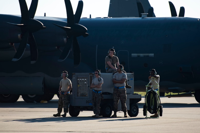 Airmen from the 71st Aircraft Maintenance Unit await the departure of an HC-130J Combat King II Aug. 30, 2019, at Moody Air Force Base (AFB), Ga. The aircraft was used to transport personnel and equipment to Little Rock AFB, Ark. in support of Hurricane Dorian aircraft relocation efforts. (U.S. Air Force photo by Senior Airman Erick Requadt)
