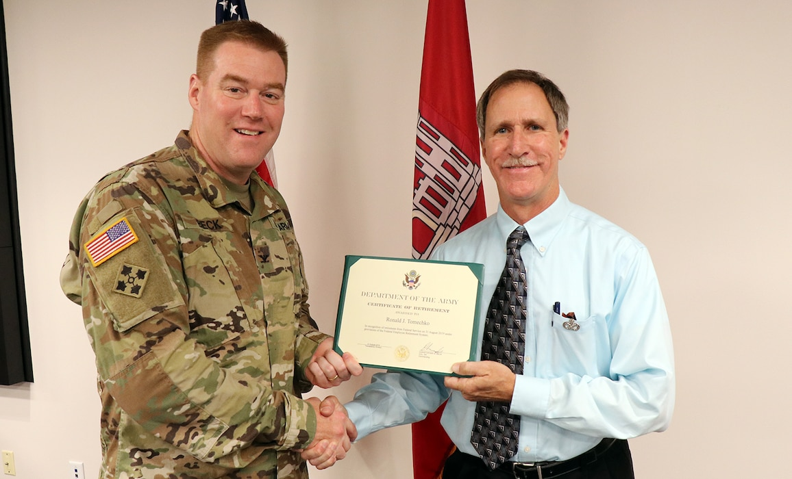 Transatlantic Division Commander Col. Christopher Beck presents the Department of the Army Superior Civilian Service Medal to Ronald J. Tomechko for his years of dedicated service to USACE and the American public. The medal was presented during Tomechko's retirement ceremony on Aug. 29, 2019, at TAD's headquarters in Winchester, Virginia.