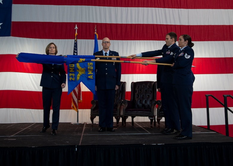 Col. Tiffany Morgan, 23d Medical Group commander, uncovers the 23d Operational Medical Readiness Squadron guidon during a redesignation ceremony, Aug. 30, 2019, at Moody Air Force Base, Ga. The redesignation ceremony marked the transition of both the 23d Aerospace Medicine Squadron to the 23d Operational Medical Readiness Squadron and the 23d Medical Operations Squadron to the 23d Healthcare Operations Squadron. The redesignation was part of an Air Force-wide medical transformation directive to provide more effective and efficient ways to care for Team Moody Airman and restore squadron readiness to execute the mission. (U.S. Air Force photo by Airman Azaria E. Foster)