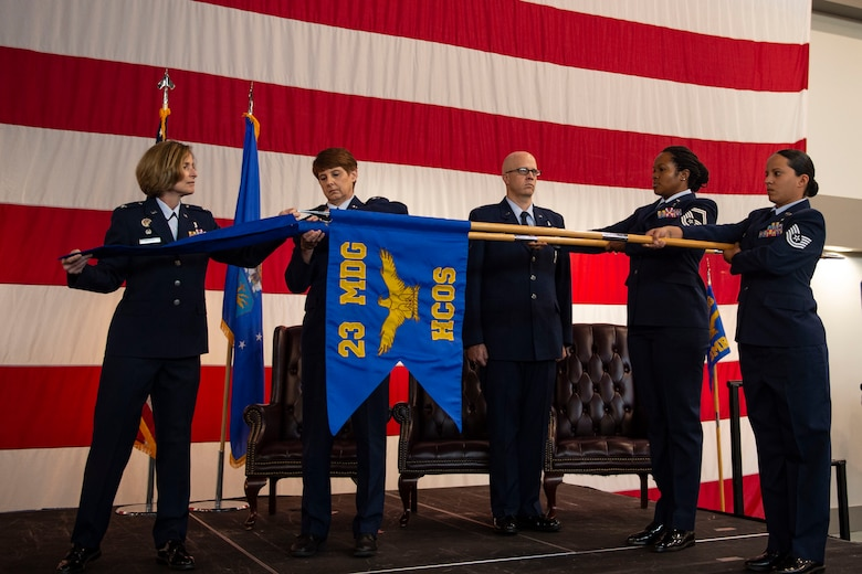 Col. Tiffany Morgan, 23d Medical Group commander, covers the 23d Medical Operations Squadron guidon during a redesignation ceremony, Aug. 30, 2019, at Moody Air Force Base, Ga. The redesignation ceremony marked the transition of both the 23d Aerospace Medicine Squadron to the 23d Operational Medical Readiness Squadron and the 23d Medical Operations Squadron to the 23d Healthcare Operations Squadron. The redesignation was part of an  Air Force-wide medical transformation directive to provide more effective and efficient ways to care for Team Moody Airman and restore squadron readiness to execute the mission.  (U.S. Air Force photo by Airman Azaria E. Foster)