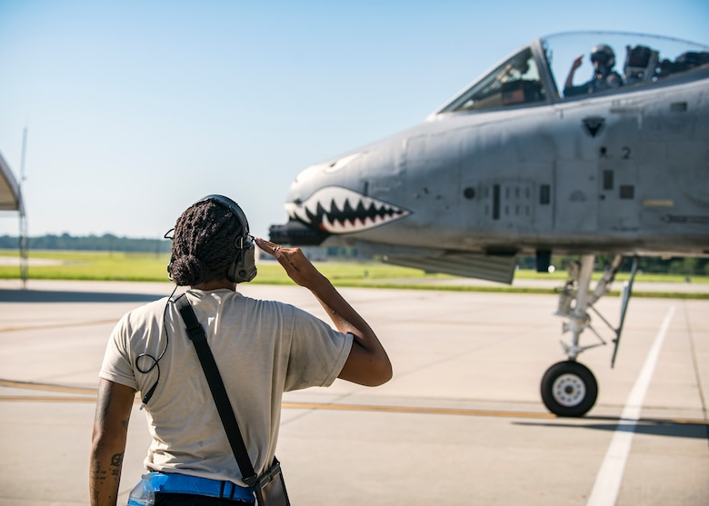 Senior Airman Tori Payne, left, 74th Aircraft Maintenance Unit crew chief, salutes a pilot from the 74th Fighter Squadron prior to takeoff for Little Rock AFB, Ark., Aug. 30, 2019, at Moody Air Force Base, Ga. Moody's A-10C Thunderbolt II's were relocated to Little Rock in anticipation of Hurricane Dorian. (U.S. Air Force photo by Airman 1st Class Eugene Oliver)