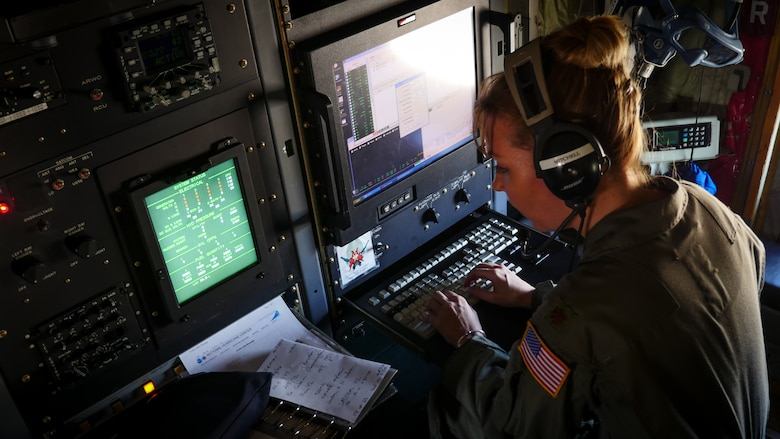 "Air Force Reserve Maj. Nicole Mitchell, aerial reconnaissance weather officer, 53rd Weather Reconnaissance Squadron, Keesler Air Force Base, Mississippi, records weather information while flying into Hurricane Irma, Sep. 8, 2017. The Air Force Reserve 53rd Weather Reconnaissance Squadron ""Hurricane Hunters"" fly WC-130J Super Hercules though the eye of active hurricanes to collect weather data using aircraft and externally dropped sensors to provide accurate weather data to the National Hurricane Center on approaching hurricanes. The Reserve Citizen Airmen provide 100 percent of the Air Force capability in low-level, real time data collection in Atlantic and Pacific Ocean tropical weather systems. (U.S. Air Force photo by Staff Sgt. Corban Lundborg)"