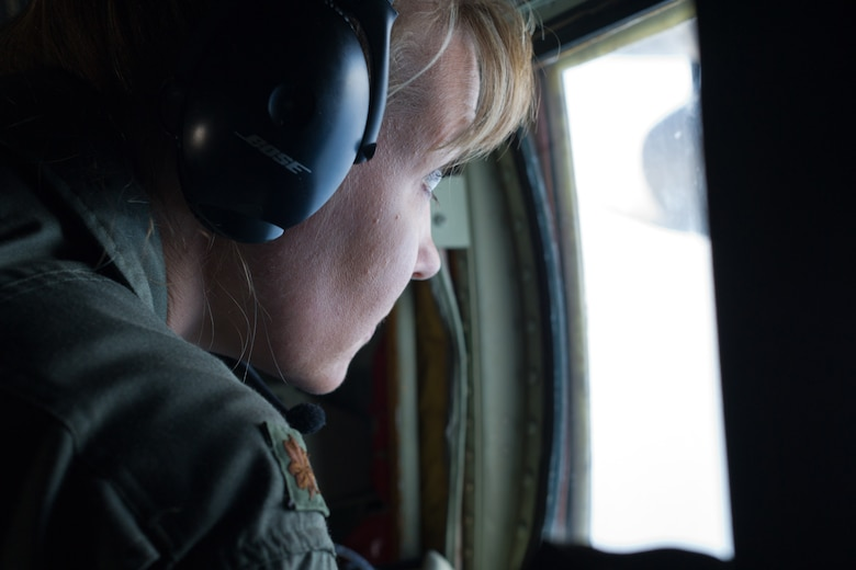 "Air Force Reserve Maj. Nicole Mitchell, aerial reconnaissance weather officer, 53rd Weather Reconnaissance Squadron, Keesler Air Force Base, Mississippi, looks out her observation window while flying into Hurricane Irma Sep. 8, 2017. The Air Force Reserve 53rd Weather Reconnaissance Squadron ""Hurricane Hunters"" fly WC-130J Super Hercules though the eye of active hurricanes to collect weather data using aircraft and externally dropped sensors to  provide accurate weather data to the National Hurricane Center on approaching hurricanes. The Reserve Citizen Airmen provide 100 percent of the Air Force capability in low-level, real time data collection in Atlantic and Pacific Ocean tropical weather systems. (U.S. Air Force photo by Staff Kyle Brasier)"