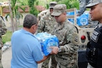 Puerto Rico Army National Guard soldiers continue their efforts of distributing much-needed supplies to communities around the Island in the aftermath of Hurricane Maria in Cidra, Puerto Rico, Nov 27, 2017. Water was delivered to a nursing home for elderly Alzheimer patients.