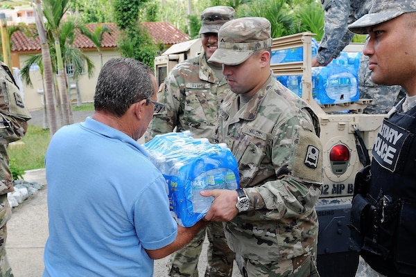 Puerto Rico Army National Guard soldiers continue their efforts of distributing much-needed supplies to communities around the Island in the aftermath of Hurricane Maria in Cidra, Puerto Rico, Nov 27, 2017.