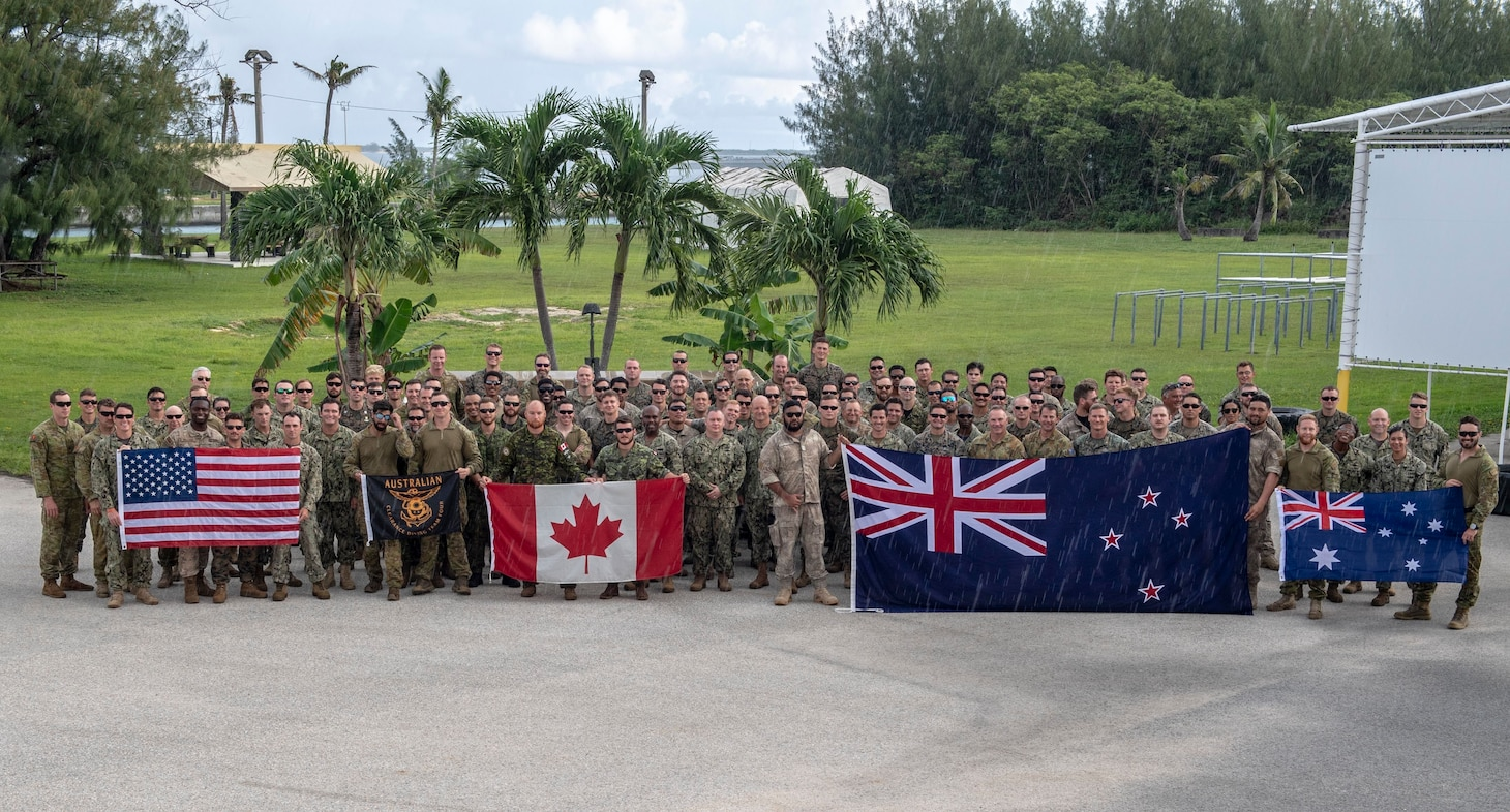 SANTA RITA, Guam (Aug. 30, 2019) Expeditionary forces from Australia, Canada, New Zealand and the United States pose for a group photo during Exercise HYDRACRAB. HYDRACRAB is a quadrilateral exercise conducted by forces from Australia, Canada, New Zealand, and U.S. Naval forces. The purpose of this exercise is to prepare the participating Explosive Ordnance Disposal (EOD) forces to operate as an integrated, capable, and potent allied force ready to respond to a changing and complex maritime environment in the Indo-Pacific region.