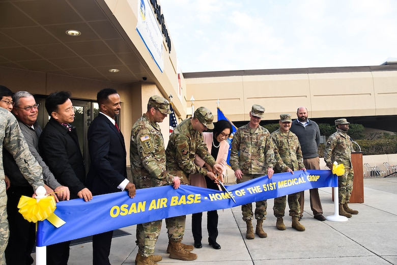 Col. Christopher Crary, U.S. Army Corps of Engineers (USACE), Far East District (FED) commander, along with other distinguished guests, participate in the 51st Medical Group Hospital expansion and renovation ribbon cutting ceremony, Osan Air Base, South Korea, Nov. 26. (Photos by Antwaun J. Parrish)