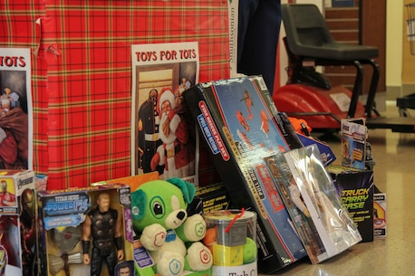 CAMP HUMPHREYS, South Korea -- Marines with U.S. Marine Corps Forces Korea volunteer at a Toys for Tots stand here on Dec. 1.  The Marines' Toys for Tots program is an annual campaign held by U.S. Marine Corps Reserve around the holidays to help less fortunate children. The collected toys will be donated to local children's hospitals and orphanages in Korea. (U.S. Marine Corps photos by Sgt. Parker R. Golz)