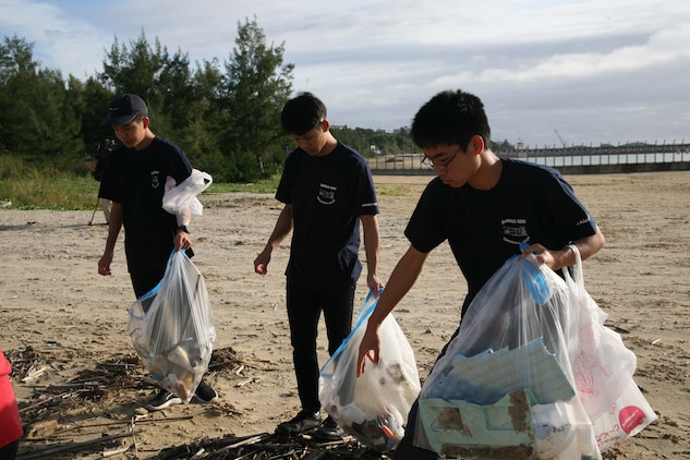 High school students picked up debris from Henoko beach Nov. 24, 2019. High school students from all over Japan concerning the problem of marine plastic waste visited Camp Schwab to join the Marines of Camp Schwab's Single Marine Program in cleaning Henoko beach. After the beach cleanup, the students presented a certificate of appreciation to Marines who regularly participate beach cleanups in all over Okinawa.