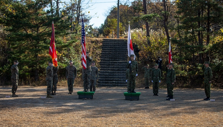 U.S. Marines with 1st Battalion, 25th Marine Regiment, currently assigned to 4th Marine Regiment, 3rd Marine Division, under the Unit Deployment Program, and Soldiers with 8th Infantry Regiment, Japan Ground Self-Defense Force, participate in an opening ceremony during Forest Light Middle Army in Aibano Training Area, Shiga, Japan, Dec. 1, 2019. Forest Light Middle Light is an annual training exercise that is designed to enhance the collective defense capabilities of the United States and Japan Alliance by allowing infantry units to maintain their lethality and proficiency in infantry and combined arms tactics. (U.S. Marine Corps photo by Lance Cpl. D'Angelo Yanez)