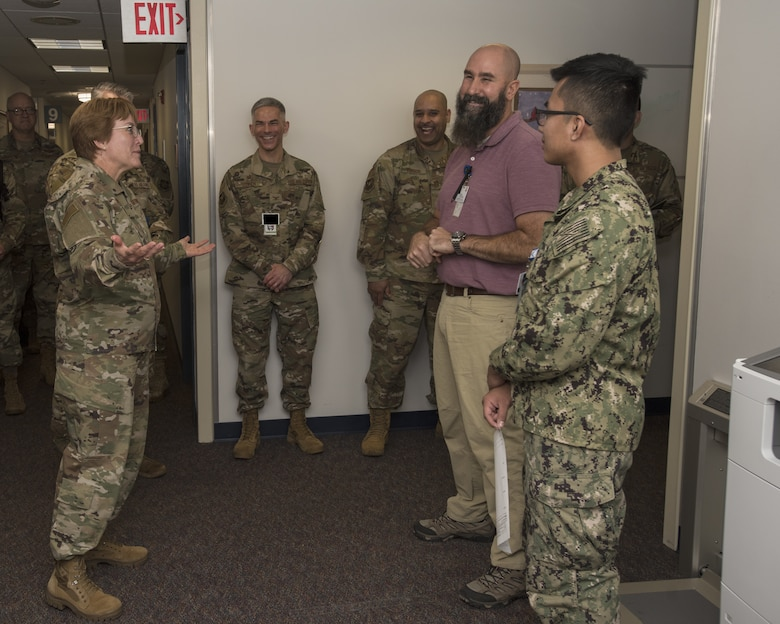 Lt. Gen. Dorothy Hogg, U.S. Air Force Surgeon General, laughs with members from the 87th Medical Group during a tour at Joint Base McGuire-Dix-Lakehurst, N.J., Nov. 21, 2019. Hogg toured different units within the MDG and learned of innovations and new systems the team has implemented to provide quality patient care. A new program the MDG is implementing is Sick Call; a system for Active Duty military members to receive immediate care on non-emergent illnesses in an effort to alleviate appointment loads and wait times for care. (U.S. Air Force illustration by Airman 1st Class Ariel Owings)