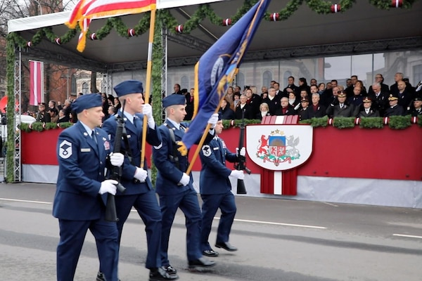 Members of the Michigan Air National Guard pass the official viewing party during the Latvian Independence Day military parade through Riga, Latvia, Nov. 18, 2019.