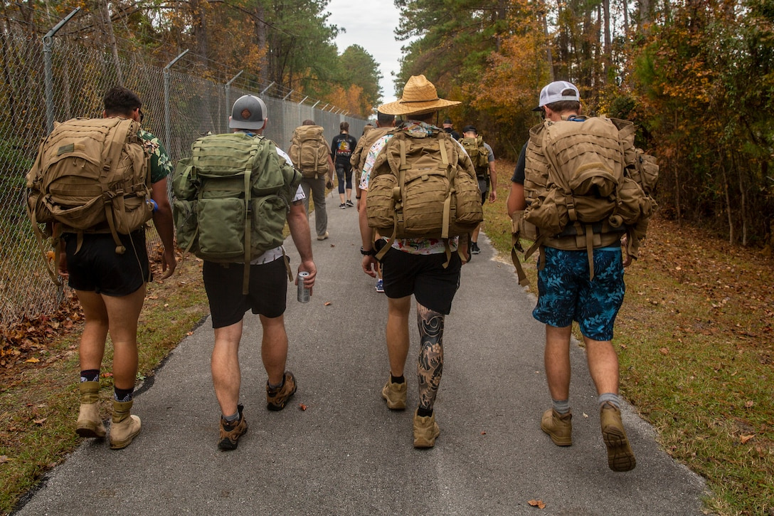 U.S. Marines and Sailors with 2nd Reconnaissance Battalion, 2nd Marine Division participate in charity ruck march in Jacksonville, North Carolina, Nov. 27, 2019. The Marines hiked from the Camp Lejeune main gate to the United Way's Children Healthy Eating on the Weekend house. The march supports CHEW! program which provides underprivileged children with donated food every weekend.