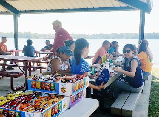 Aeropropulsion Combined Test Force team members and their families socialize during a cookout Oct. 5 at Arnold Lakeside Center as part of a Family Day. The Family Day event provided an opportunity for everyone to get to know one another and gave families some insight about the work being done at Arnold Air Force Base. In addition to lunch at the ALC, Aeropropulsion CTF team members and their families received a tour of some of the facilities on base. (Courtesy photo)