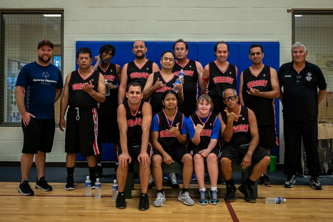 Participants and their coaches pose for a group picture during the Special Olympics Hawaii Holiday Classic State Games, Marine Corps Base Hawaii, Nov. 23, 2019. SOHI provides sports training throughout the year and athletic competition in a variety of Olympic sports for persons with intellectual or development disabilities. MCBH began supporting the SOHI event in 1997.