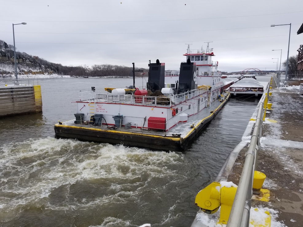 Tow boat departing a lock chamber