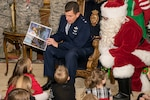 The Adjutant General of Colorado U.S. Air Force Maj. Gen. Michael Loh reads a holiday storybook entitled,