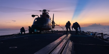 Crewmembers of the Coast Guard Cutter Mohawk conduct night helicopter tie-down operations.