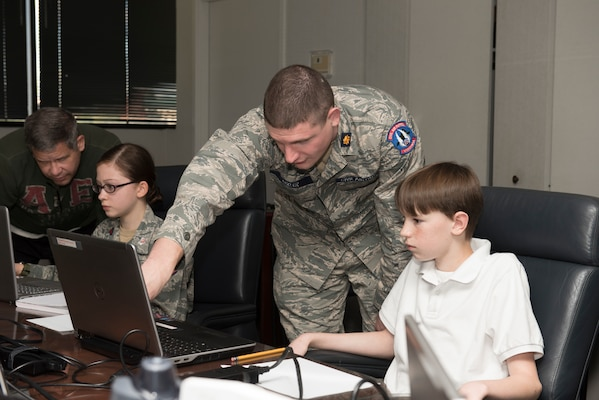 Civil Air Patrol Maj. Jacob Bixler, the Wing Director of Cadet Programs for Virginia Wing, CAP, assists CAP cadets before the start of the CyberPatriot Competition, Oct. 27, 2019.  Bixler is also a radio frequency transmissions systems craftsman for the 167th AW.