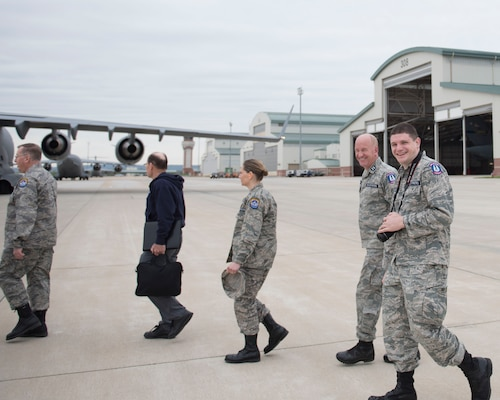 Civil Air Patrol Maj. Jacob Bixler, far right, walks across the flight line to a C-17 Globemaster III aircraft with fellow CAP members, at the 167th Airlift Wing, West Virginia Air National Guard, May 17, 2019, as part of an orientation flight. Bixler is the Wing Director of Cadet Programs for Virginia Wing, CAP. He is also a radio frequency transmissions systems craftsman for the 167th AW