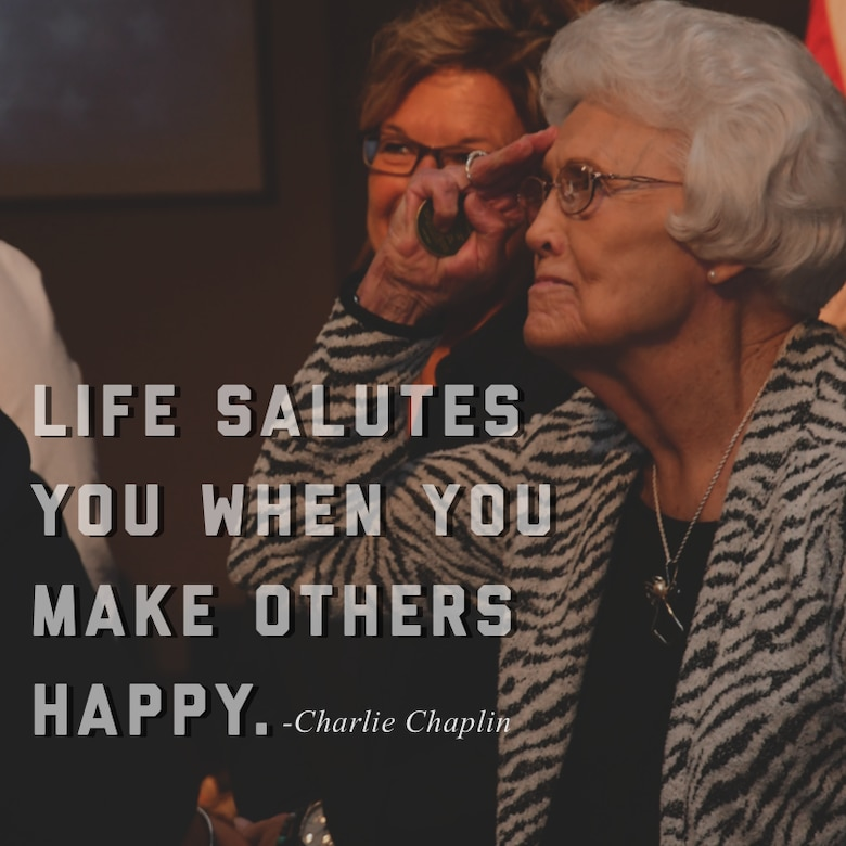 """This week's motivation is courtesy of comedic actor, Charlie Chaplin, who said, """"Life salutes you when you make others happy."""" (U.S. Air Force graphic/Tech. Sgt. Andrew Park)"""