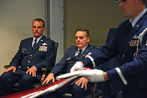 t. Col. Edward Tarquinio, center, 758th Airlift Squadron pilot, watches as members of the 911th Airlift Wing Honor Guard fold the flag during his retirement ceremony at the Pittsburgh International Airport Air Reserve Station, Pennsylvania, Nov. 3, 2019.