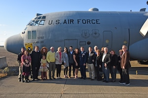 Lt. Col. Edward Tarquinio, center, poses for a photo with family and friends in front of a static C-130 Hercules at the Pittsburgh International Airport Air Reserve Station, Pennsylvania, Nov. 3, 2019.