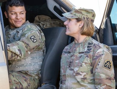Pvt. 1st Class Jon Solano, an infantryman assigned to Bravo Company, 2nd Infantry Battalion, 4th Infantry Regiment, 3rd Brigade Combat Team, 10th Mountain Division, gives Lt. Gen. Laura J. Richardson, Commanding General, U.S. Army North, a demonstration on the operation of the mobile surveillance camera truck near Tucson, Arizona, Nov. 26, during a visit to service members working along the U.S. southern border.