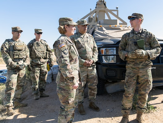 Sgt. Alexander Herakovich, an infantry team leader assigned to Bravo Company, 2nd Infantry Battalion, 4th Infantry Regiment, 3rd Brigade Combat Team, 10th Mountain Division, briefs Lt. Gen. Laura J. Richardson, Commanding General, U.S. Army North, and Command Sgt. Major Alberto Delgado, ARNORTH Senior Enlisted Advisor, on his roles and responsibilities at a mobile surveillance camera site near Tucson, Arizona, during their visit to service members serving along the U.S. southern border Nov. 26.