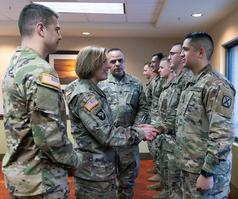 Lt. Gen. Laura J. Richardson, Commanding General, U.S. Army North, and Command Sgt. Major Alberto Delgado, ARNORTH Senior Enlisted Advisor, recognize a group of Soldiers assigned to Bravo Company, 2nd Infantry Battalion, 4th Infantry Regiment, 3rd Brigade Combat Team, 10th Mountain Division for their hard work during their visit to service members working along the U.S. southern border in Tucson, Arizona Nov. 26.