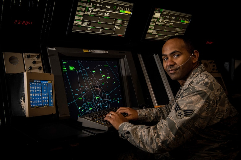 U.S. Air Force Senior Airman James Martin Jr., 60th Operational Support Squadron air traffic control journeyman poses for a portrait in the instrument flight rule room Nov. 25, 2019, at Travis Air Force Base, California. The Warrior of the Week program recognizes outstanding Airmen who have made significant contributions to their unit.  (U.S. Air Force Photo by Nicholas Pilch)