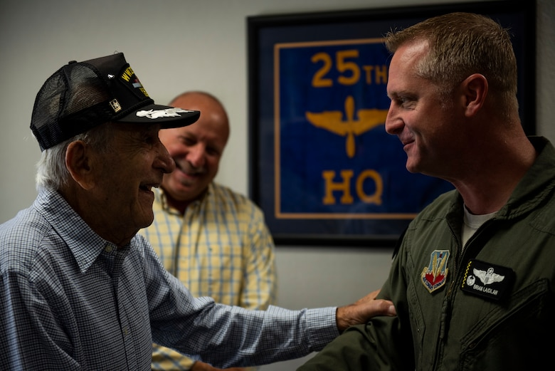 Retired U.S. Air Force Lt. Col. Daniel Daube, left, Thomas Bonifay, 325th Fighter Wing public affairs community relations liaison, center, speak to U.S. Air Force Col. Brian Laidlaw, 325th Fighter Wing commander, right, at Tyndall Air Force Base, Florida, Nov. 27, 2019. Daube, a veteran of World War II, Korean, and Vietnam war, visited Tyndall Air Force Base and toured multiple facilities. (U.S. Air Force photo by Staff Sgt. Magen M. Reeves)