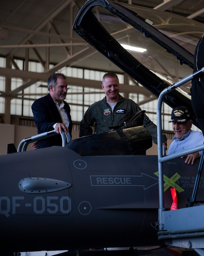Dr. Daniel Daube, left, U.S. Air Force Col. Brian Laidlaw, 325th Fighter Wing commander, center, and Retired U.S. Air Force Lt. Col. Daniel Daube, right, visited the 325th Fighter Wing and viewed a QF-16 Fighting Falcon at Tyndall Air Force Base, Florida, Nov. 27, 2019. Daube was a veteran of World War II, Korean, and Vietnam war, flying multiple air frames and combat missions. Daube visited a static QF-16 Fighting Falcon and sat in the cockpit for the first time in many years. (U.S. Air Force photo by Staff Sgt. Magen M. Reeves)