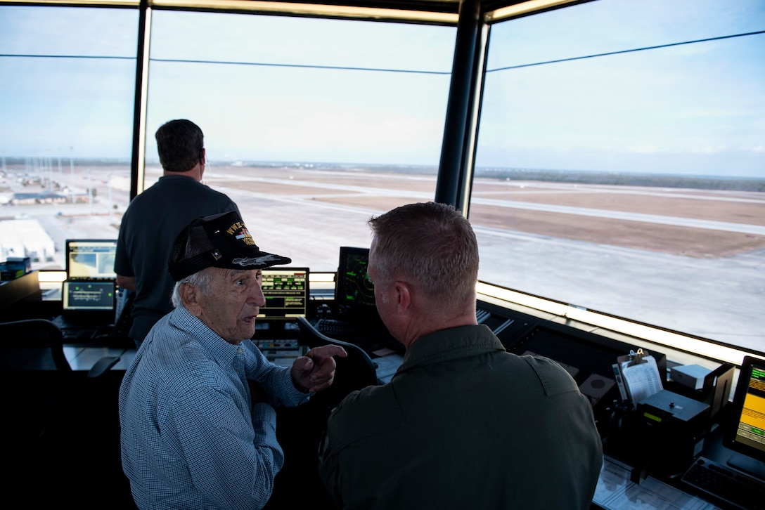 Retired U.S. Air Force Lt. Col. Daniel Daube, left, speaks to U.S. Air Force Col. Brian Laidlaw, 325th Fighter Wing commander, in the air traffic control tower at Tyndall Air Force Base, Florida, Nov. 27, 2019. Daube was a veteran of World War II, Korean, and Vietnam war, flying multiple air frames and combat missions. Daube visited Tyndall's air traffic control tower and saw planes launch off the runway. (U.S. Air Force photo by Staff Sgt. Magen M. Reeves)