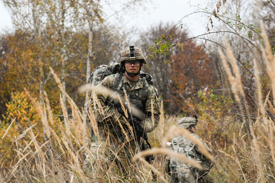 U.S. Army Spc. Sean Gilbert, looks to the rear of a tactical formation during a reconnaissance and surveillance rehearsal exercise at Lešť military training center, Slovakia.