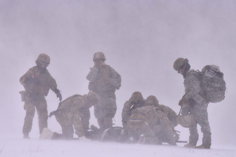 Soldiers train in blowing snow.