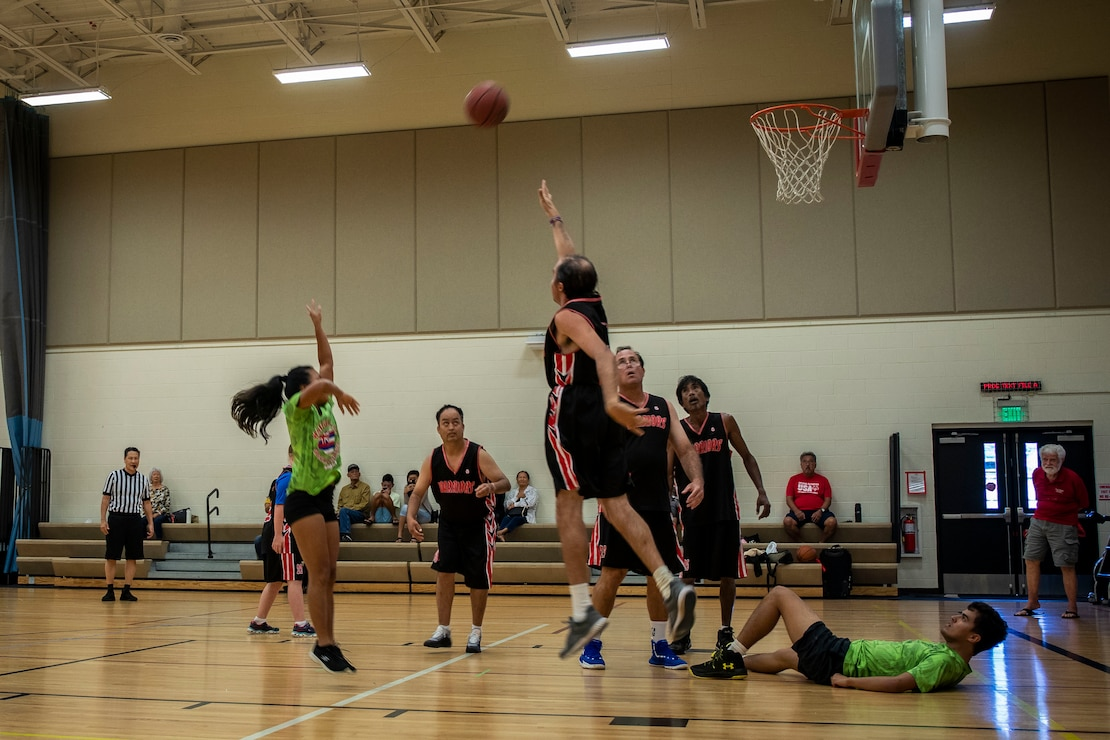 Participants compete in a basketball game during the Special Olympics Hawaii Holiday Classic State Games on Marine Corps Base Hawaii Nov. 23.